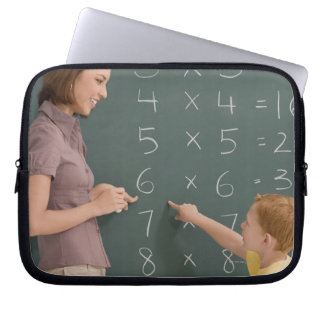 Side profile of a female teacher teaching her laptop sleeve