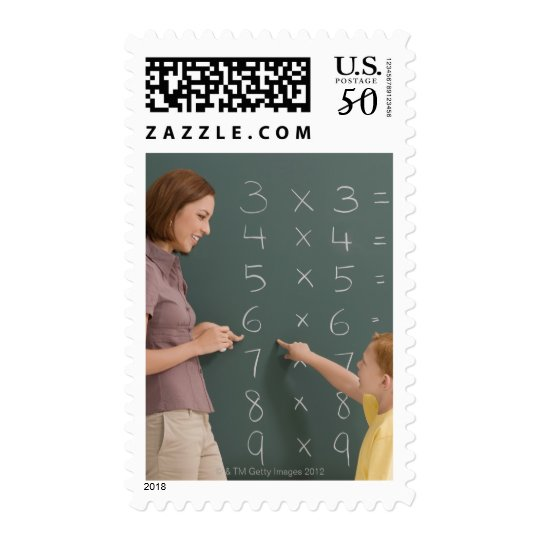 Side profile of a female teacher teaching her postage