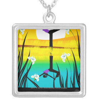 Side profile of a woman practicing yoga silver plated necklace