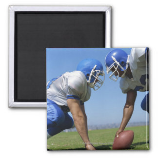 side profile of two football players playing on magnet