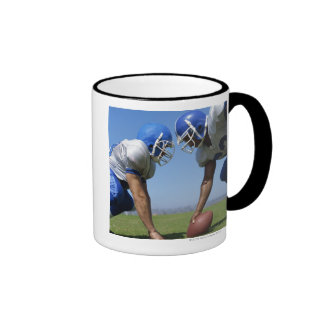 side profile of two football players playing on ringer coffee mug
