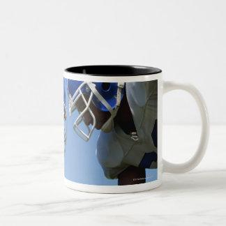 side profile of two football players playing on Two-Tone coffee mug