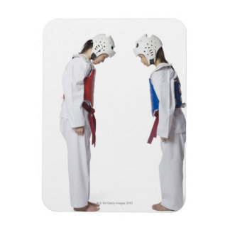 Side profile of two taekwondo players bowing magnet