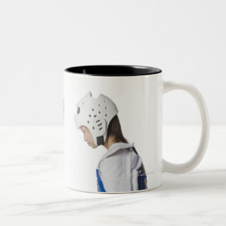 Side profile of two taekwondo players bowing Two-Tone coffee mug