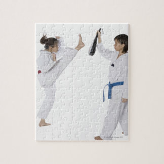 Side profile of two young women practicing jigsaw puzzle