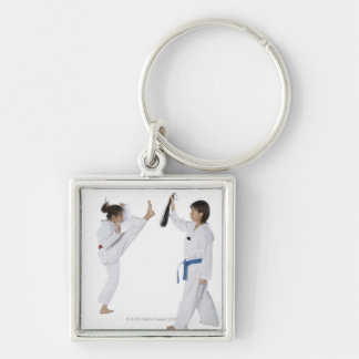 Side profile of two young women practicing keychain