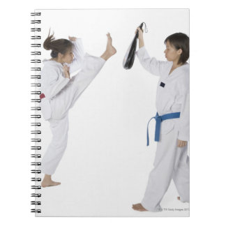 Side profile of two young women practicing spiral notebook