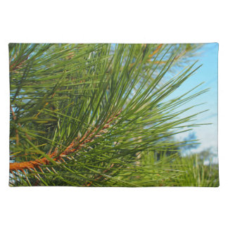 Side view of a pine branch with long needles close cloth placemat