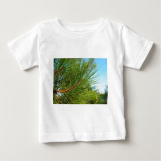 Side view of a young pine tree branch with long ne baby T-Shirt