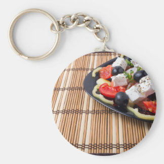 Side view of fresh vegetarian salad on plate keychain