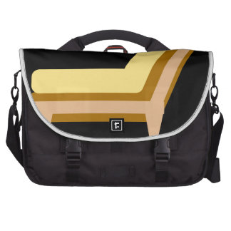 Side view of home or office furniture- sofa laptop computer bag