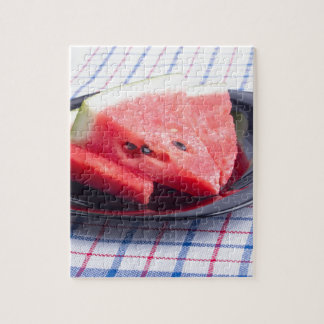 Side view of juicy red watermelon pieces jigsaw puzzle