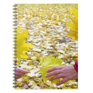 Side view of the hands of young girls and women cl spiral notebook