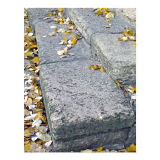 Side view of the steps of the old gray stone block letterhead