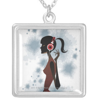 Side view of woman listening music silver plated necklace