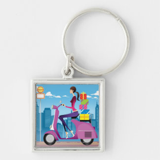 Side view of woman with gifts on scooter keychain