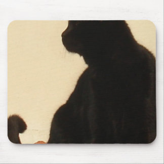 Side View Silhouette of A Black Cat Sitting On A R Mouse Pad