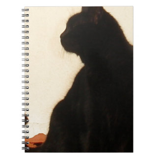 Side View Silhouette of A Black Cat Sitting On A R Spiral Notebook