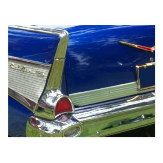 Side white tailfin on blue classic car post card