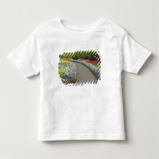 Sidewalk pathway through tulips and daffodils, 2 toddler t-shirt