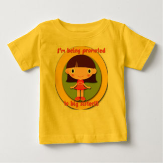 Siendo promovido a la camiseta infantil del niño