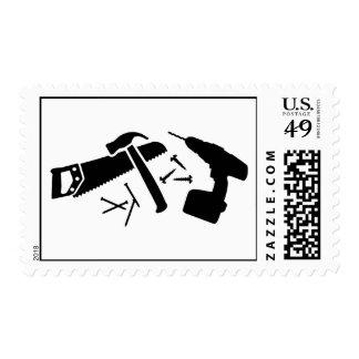 Sierra de los clavos del martillo del timbre postal