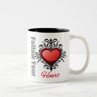 Siga su corazón taza de café