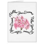 Siga sus flores rosadas de los sueños felicitación
