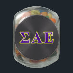 "Sigma Alpha Epsilon Purple and Yellow Letters Glass Jar<br><div class=""desc"">Check out these official Sigma Alpha Epsilon designs! Personalize your own Greek merchandise on Zazzle.com! Click the Customize button to insert your own name, class year, or club to make a unique product. Try adding text using various fonts &amp; view a preview of your design! Zazzle&#39;s easy to customize products...</div>"