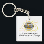 "Sigma Gamma Nu 45th Anniversary Official Key Chain<br><div class=""desc"">Let this commemorative key chain accompany you on the go. This accessory features the official Sigma Gamma Nu 45th Anniversary logo.</div>"