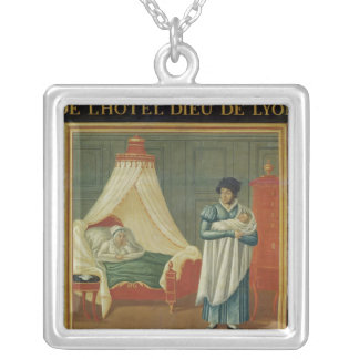 Sign advertising the services of a midwife silver plated necklace