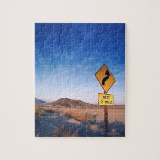 Sign on the death valley road in sunset jigsaw puzzle