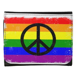 Signo de la paz apenado de la bandera del arco iri