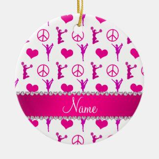 Signo de la paz blanco rosado conocido de los adorno navideño redondo de cerámica