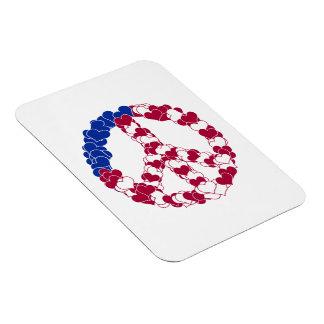 Signo de la paz blanco y azul rojo hecho con los c imanes