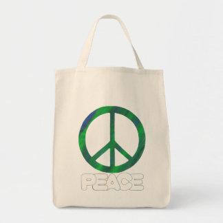 Signo de la paz con el texto del esquema, las bolsa tela para la compra