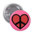 Signo de la paz en un botón del corazón pins