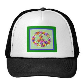 Signo de la paz floral con la frontera verde y azu gorras