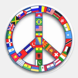 Signo de la paz hecho de las camisetas de las pegatina redonda