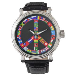Signo de la paz hecho del reloj global de las