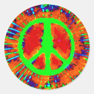 Signo de la paz psicodélico abstracto del teñido etiqueta redonda