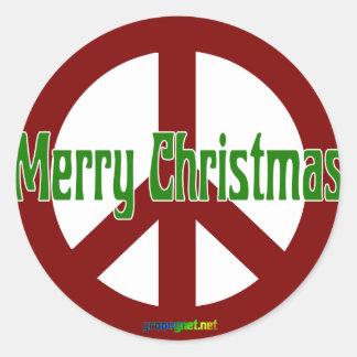 Signo de la paz rojo con Felices Navidad Pegatina Redonda