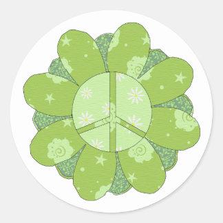 Signo de la paz verde de la flor pegatina redonda