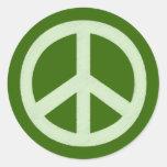 Signo de la paz verde en colores pastel etiquetas redondas