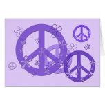 Signos de la paz púrpuras en tarjetas y pegatinas