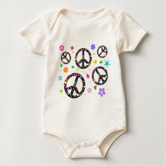 Signos de la paz y flores mameluco de bebé