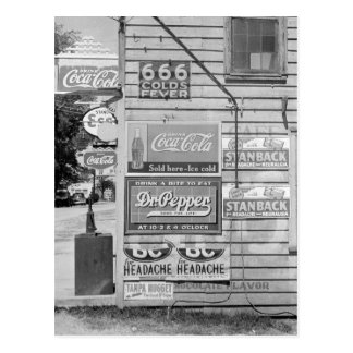 Signs on a General Store, 1938 Postcard