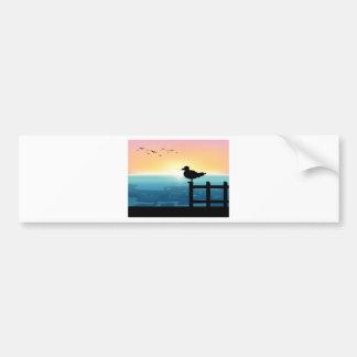 Sihouette bird at sea car bumper sticker