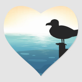 Sihouette bird at sea heart sticker