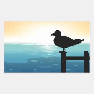 Sihouette bird at sea rectangular sticker